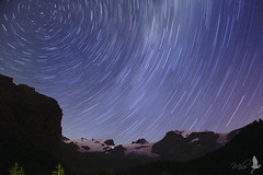 Lunga esposizione [Explored] (_milo_) Tags: italy night canon stars eos italia nuit montagna notte startrails manfrotto champoluc stelle 18135 treppiede 60d