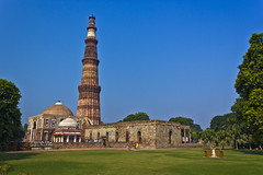 Qutub Minar (AnkurDauneria) Tags: world travel blue red sky sunlight india building tree green art heritage texture tourism monument stone architecture century canon garden landscape temple eos persian site worship asia delhi muslim tomb scenic style mosque symmetry historic unesco mausoleum monarch historical 1855mm hindu 12th ruler remains efs prayers emperor allah newdelhi qutubminar watchtower marbel ruined asi oldglory towerofvictory subcontinent redstone mughal rajput historicindia redsandstone mughalgarden archaeologicalsurveyofindia ghori 550d iltutmish incredibleindia lostempire victorytower indraprastha delhisultanate apsc qutubuddinaibak 27hindutemples