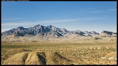Out Of The Rain (Radu.B) Tags: sky mountains nature landscape sand rocks desert nevada dry nobody roadtrip panasonic 1232 gm1