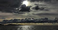 addicted to: norwegian clouds .. (Soenke HH) Tags: sea sky sun white water beauty silhouette yellow norway clouds dark coast norge wasser north skandinavien norwegen himmel wolken formation gelb fjord blau scandinavia sonne weite weiss liebe dunkel schären küste sehnsucht ferne schön bedrohlich