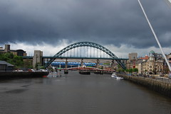 Dark clouds gathering .... (Halliwell_Michael ## More off than on this week #) Tags: city cloud water sport architecture clouds boats boat spring waterfront perspective bridges tynebridge northumberland rivers swingbridge springtime railwaybridge newcastleupontyne rivertyne nikond40x magicweekend