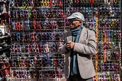 Sunglass Stall (Silver Machine) Tags: street man london sunglasses scarf lumix outdoor candid streetphotography streetportrait cap selling streetstall lumixg lumixg20mmf17 lumixg5 fujiholicsphotowalklondonmay2016