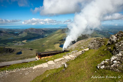 Snowdon Mountain Railway (Adrian Evans Photography) Tags: uk sea summer sky lake mountains stone wales clouds train landscape coast track carriage outdoor path smoke horizon rail railway loco landmark tourist steam trail valley snowdon summit driver coastline british locomotive passenger llanberis snowdonia seashore narrowgauge sleepers northwales mountainrailway rackandpinion newborough snowdonianationalpark snowdonsummit padarnlake snowdonmountainrailway llanddwynisland llynglas llyncoch cwmclogwyn