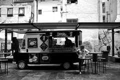 Food truck (Daniel Nebreda Lucea) Tags: street old city travel light people urban food woman white black blanco luz girl architecture truck canon calle mujer arquitectura chica shadows gente comida negro transport hipster ciudad zaragoza camion buy urbano sell sombras vender viajar comprar
