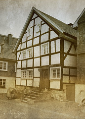 historic city center Neviges 3 of 5 (- Carsten -) Tags: city sky blackandwhite house building texture sepia architecture digital canon germany deutschland decay haus historic textures duplex architektur alemania nrw duotone schwarzweiss altstadt allemagne velbert nordrheinwestfalen alemanha fassade duitsland antik historisch texturen textur neviges fototrip