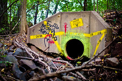 Radioactive Routing (Nick Benson Photography) Tags: school trees tree art broken water danger radio 35mm walking found photography photo student scary dangerous woods nikon funny rocks paint university do grafitti cross grafiti walk painted nick pipe cement creative radiation tunnel tape sewage caution horror imagination radioactive glowing mutant radioactivity enter benson sewer piping find hartford active lair phosphorescent phosphorus humorus not