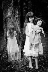 It's MY Doll (Kilkennycat) Tags: blackandwhite bw reflection tree girl forest canon vintage mirror doll child dress antique 50mm14 creepy spooky playtime bnw 500d t1i