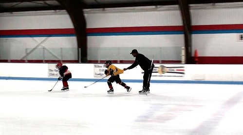 Brad Perry challenging a player during a hockey school in Chicago
