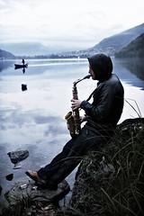 Il suonatore (ju_lien) Tags: italy music mountain snow fog montagne lago tramonto musica neve sax lombardia pescatore musicista lagodicomo piona laghettodipiona sassonfono
