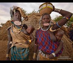 Mursi women with lip plates in the Lower Omo Valley of Ethiopia (jitenshaman) Tags: ngc nikonflickraward traveldestinationworldlocationsafricaafricanethiopiaethiopianomoloweromosouthomoomovalleytribeethnicminoritytribalprimitiveblackebonytraditiontraditionalthirdworldpovertybeadsjewelrynecklacemursilip
