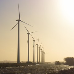 row of turbines (Ruud Otter) Tags: storm water landscape canal windturbine sunsetstrandstormpettennederland