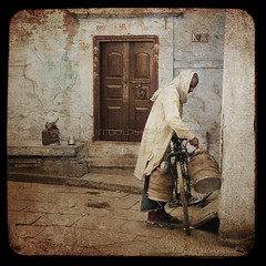 Memories & Dreams (designldg) Tags: street door people india man souls bicycle sepia square time dream atmosphere streetlife memory varanasi eternity dharma kashi timeless benares benaras milkman uttarpradesh