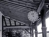 An amcient clock at an old-fashioned railway station