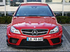 Red Perfection. 'Explored' (Niklas Emmerich Photography) Tags: worldcars thebestmercedesiveeverseen themercedesc63amgcoupeblackserieswiththetrackpackageamg affalterbach2012redcarbonperfectionblacksupercarlimited2012springgermanystuttgart63benzlbmawerkswagentestcar