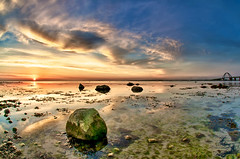 SunRockBridge (dubdream) Tags: ocean bridge sunset sea sky sun seascape beach water rock clouds germany landscape island nikon ngc baltic fisheye explore hdr fehmarn fehmarnsund d300 colorimage wetreflections sigma10mm dubdream