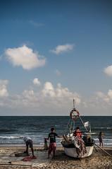 Preparativos de pesca. (jcof) Tags: ocean woman color men beach water azul boat mar mujer agua barco huelva playa pesca hombres lepe laantilla