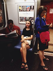 #DailyPhoto : #Between two readers. #Photography #iphoneography #365 #nyc #subway #commuter (ab_ankurbhatia) Tags: people train subway jerseycity newport iphone dailyphotoblog iphoneography ankuriview