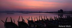 Amarapura - U Bein Bridge at Dawn (Rolandito.) Tags: morning bridge sunrise boats dawn boat dusk burma silhouettes u myanmar birma mandalay bei amarapura birmanie birmania