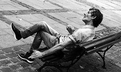 Man on park bench ..La Laguna..Tenerife (Don Jackson) Tags: life park portrait people urban man male strange face closeup composition bench weird moody hand arms legs body pavement expression cigarette seat fingers profile neglected relaxing thoughtful photojournalism documentary surreal atmosphere social tenerife mysterious denim unusual gesture fag unshaven angled global crossed ecsentric