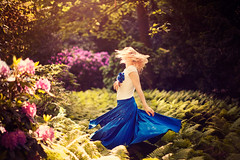 Dance in the Sunlight (Yuliya Bahr) Tags: flowers blue light sun motion beautiful sunshine forest hair dance dress blond flyinghair