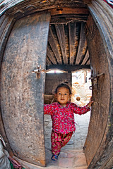 Child at the door. Bhaktapur Durbar Square, a UNESCO World Heritage Site (CamelKW) Tags: door plaza nepal child kingdom unescoworldheritagesite bhaktapur durbarsquare 2016 everestpanoram oldbhaktapur