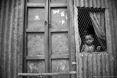 Caged Childhood ! (pusan_sm) Tags: blackandwhite bw home childhood freedom child dhaka bnw 2012 pusan closeddoor nikond90 munshiganj tokina1116mm ttlphotowalk maowa