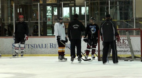 Brad Perry coaching an adult hockey group