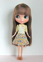 yellwo ribbon blouse and ruffle skirt