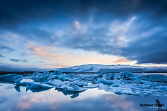 Photographer at Jkulsrln (My Little Johnny Rotten Pony) Tags: sunset mountain lake film ice set clouds landscape island iceland long exposure photographer tripod glacier block photographing