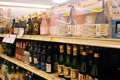 Drink Up (jjldickinson) Tags: food retail shopping japanese design bottle wine display liquor sake packaging groceries mitsuwa olympusom1 torrance fujicolorsuperiaxtra400 promastermcautozoommacro2870mmf2842 promasterspectrum772mmuv roll490o2