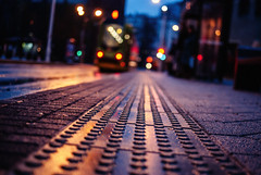 legos (ewitsoe) Tags: street city morning autumn urban wet 35mm lights bokeh pavement platform tram poland polska citycenter trams tramstop nikond80 bokehlight ewitsoe poznzna