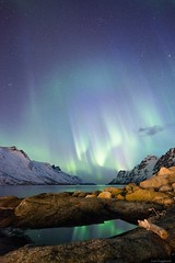Ersfjord, Troms (tryggstrand) Tags: ocean light sea sky mountain mountains nature water norway night reflections dark stars landscape lights fjord northernlights auroraborealis troms