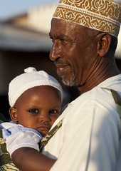 Father Carrying Baby With Coaled Eyelids During Maulidi, Lamu, Kenya (Eric Lafforgue) Tags: africa boy color island toddler kenya culture makeup unescoworldheritagesite babygirl afrika kol tradition lamu carrying swahili afrique eastafrica khol qunia kofia lafforgue traveldestination africanethnicity  qunia   113726  kea   tradingroute birthoftheprophet a