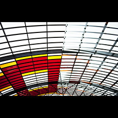 Colors from above (Maerten Prins) Tags: roof red orange white reflection glass colors lines station amsterdam yellow grid colours squares trainstation panels canopy centraal upshot