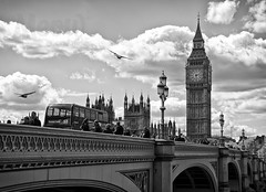 Half Three in Westminster (peterotoole) Tags: greatbritain bridge blue light red england sky people blackandwhite bw seagulls white london tower clock apple water buses birds thames skyline architecture clouds photoshop river mac aperture nikon europe raw arch traffic zoom unitedkingdom britain tripod country capital  housesofparliament parliament bigben tourists queen iso peter processing handheld british lamps dslr range riverthames royalty westminsterbridge victoriatower otoole touristdestination d7k d7000 nikond7000 peterotoole