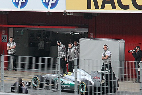 Nico Rosberg drives into his pit garage at Formula One Winter Testing, Circuit de Catalunya, March 2012