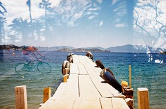 Jetty/Ghostrider (dear_jem) Tags: blue sea holiday colour film water xpro aqua doubleexposure olympus double analogue elitechrome vivitar skiathos showntell barceolan