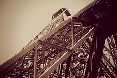 Eiffel Tower (Evelieeenn) Tags: city summer brown paris france detail building monument lines statue sepia architecture digital canon french photography photo high europe famous eiffeltower perspective picture july architect digitalcamera popular 2012 letoureiffel canoneosdigitalrebelxti gustafeiffel instagramapp evelienpeeters