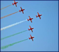 Surging forward....Independence Day greetings! (I Nair) Tags: red freedom bluesky airshow airforce aerobatics daredevils aerobaticteam aeroindia jaihind suryakirans indiantric