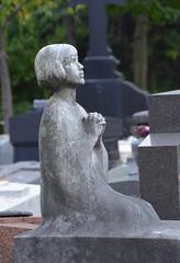 Kneeling young girl praying (Monceau) Tags: woman statue praying young kneeling cimetireduprelachaise