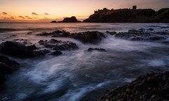 Cold Dawn (ScottSimPhotography) Tags: ocean morning winter sea cold castle water clouds sunrise dawn golden coast scotland rocks sony famous scottish wideangle location coastal northsea hour 12mm northern dunnottar stonehaven swirling rokinon a6000