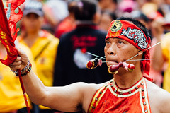 Debus Performer with Spikes in Cheeks and Ears (AdamCohn) Tags: new pierced indonesia year chinese chinesenewyear piercing jakarta pierce bodymod spikes debus bodymodification glodok banten adamcohn wwwadamcohncom