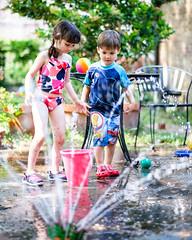 DSCF0673 (djandzoya) Tags: water backyard play sam candid siblings sprinkler fujifilm provia fenya