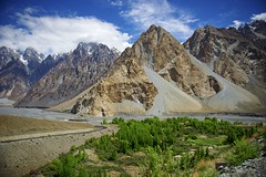DSC3606 Standing out. (najeebmahmud) Tags: blue trees pakistan light summer sky mountains tree green nature water clouds river landscape nikon highway asia village north bluesky karakoram kkh hunza passu 2470mm d810 nikond810 nikkor2470mm