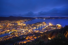 Night-time Norway (TheFella) Tags: ocean city longexposure blue houses light sunset sea urban sun mountain mountains streets slr norway night digital port photoshop canon buildings dark landscape boats eos gold lights golden norge photo high lowlight europe cityscape darkness traffic dynamic harbour dusk ships trails nighttime photograph hour processing slowshutter 5d inlet nordic lighttrails veins bluehour bergen dslr scandinavia range hdr highdynamicrange hordaland funicular urbanlandscape flyen markii sevenmountains postprocessing photomatix flyfjellet kingdomofnorway thefella 5dmarkii conormacneill thefellaphotography sevenmountainsofbergen lpgolden
