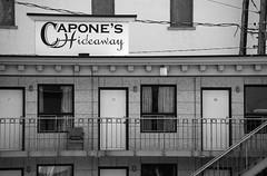 Capone's Hideaway (peterkelly) Tags: door bw window sign stairs digital chair room motel stairway northamerica saskatchewan railing moosejaw caponeshideaway