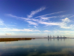 Clouds over Thamesport (suvodeb) Tags: sea port docks sailing ship cargo cranes loading freighter thamesport