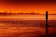Waiting In Line (Boyd Hunt) Tags: sunset red sea sky man men industry beach water statue sunrise dawn sand iron wind ironman gormley crosby turbines antonygormley anotherplace blinkagain