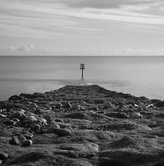 Groyne ..... with pebbles (Petur) Tags: longexposure sea stone blackwhite seaside pebbles groyne blackwhitephotos bej innamoramento