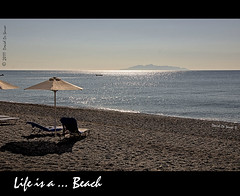 Life is a ... Beach [EXPLORED] (Far & Away (On assigment, mostly off)) Tags: life light sun reflection beach relax island volcano sand europa europe santorini greece grecia caldera rest volcanic isla thira thera aegeansea